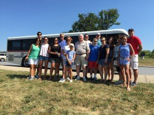 family standing in front of a gettysburg tour bus
