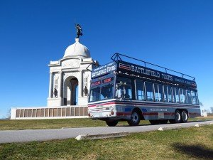 gettysburg bus tours driving by a battlefield monument