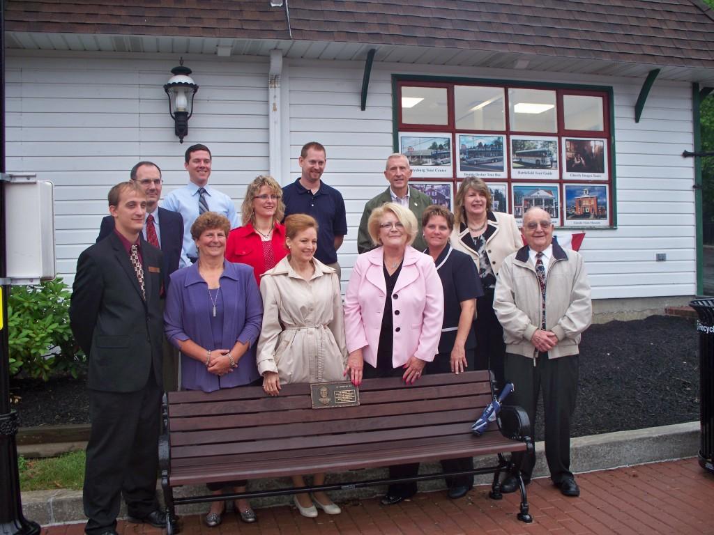 gettysburg team around dedicated bench for Ken Rohrbaugh