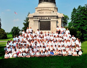 a group of students in front of the new york monument at gettysburg
