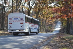 gettysburg bus tours bus heading down road surrounded by fall trees