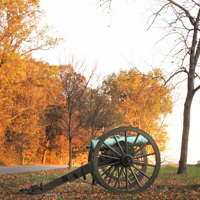 a cannon on the battlefield in fall