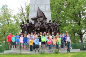 Group standing in front of a Gettysburg monument