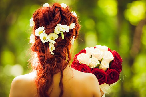 red headed bride holding flowers