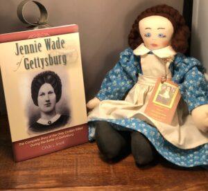 Jennie Wade Doll sitting beside the jennie wade gettysburg book